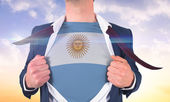 Businessman opening shirt to reveal argentina — Stock Photo