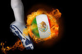 Football player kicking flaming mexico ball — Stock Photo