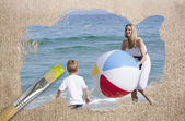 Composite image of mother and son on the beach — Stock Photo