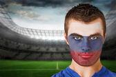 Russia football fan in face paint — Stock Photo