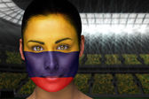 Composite image of beautiful colombia fan in face paint — Stock Photo