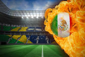 Composite image of fire surrounding mexico flag football — Stock Photo
