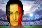 Composite image of beautiful belgian fan in face paint — Stock Photo