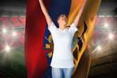 Pretty football fan in white cheering holding  flag — Stock Photo