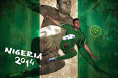 Football player in green kicking — Stock Photo