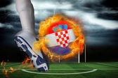 Football player kicking flaming croatia flag ball — Stock Photo