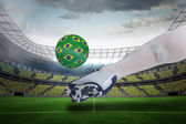 Close up of football player kicking brasil ball — Stock Photo