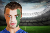 Ivory coast football fan in face paint — Stock Photo