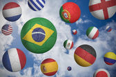 Composite image of footballs in various flag colours  — Stock Photo