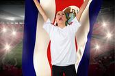 Football fan in white cheering holding costa  rica flag — Stock Photo