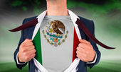 Businessman opening shirt to reveal mexico flag — Stock Photo