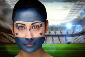 Composite image of beautiful honduras fan in face paint — Stock Photo