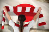 Composite image of football fan waving red and white scarf — Stock Photo
