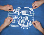 Multiple hands drawing camera with chalk — Stock Photo