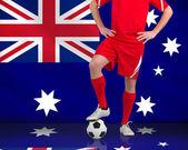 Obraz kompozytowy stojący z piłka piłkarz — Zdjęcie stockowe