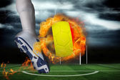 Football player kicking flaming belgium flag ball — Stock Photo