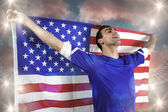 American soccer fan holding flag — Stockfoto