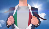 Businessman opening shirt to reveal italy flag — Stock Photo