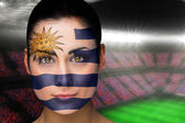 Composite image of beautiful uruguay fan in face paint — Stock Photo