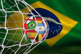 Composite image of football in multi national colours at back of — Stock Photo