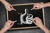 Multiple hands drawing thumb up with chalk — Stock Photo