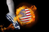 Football player kicking flaming usa ball — Stock Photo