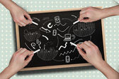 Multiple hands drawing brainstorm with chalk — Stock Photo