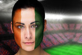 Composite image of beautiful ivory coast fan in face paint — Stock Photo