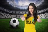 Pretty football fan in brasil tshirt — Stock Photo