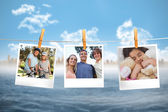 Composite image of instant photos hanging on a line — Stock Photo