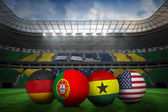 Composite image of footballs in group g colours for world cup — Stock Photo