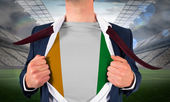 Businessman opening shirt to reveal ivory coast flag — Stock Photo