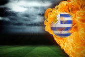 Composite image of fire surrounding uruguay flag football — Stock Photo