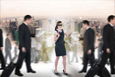 Composite image of redhead businesswoman in a blindfold — Stock Photo
