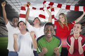Composite image of various football fans — Stock Photo