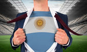 Businessman opening shirt to reveal argentina flag — Stock Photo