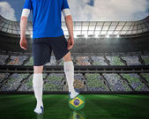 Football player standing with brasil ball — Stock Photo