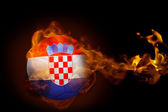 Composite image of fire surrounding croatia ball — Stock Photo