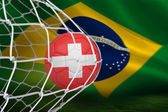 Imagen compuesta del fútbol en suiza colores en la parte posterior de la red — Foto de Stock