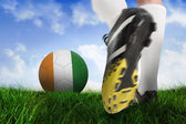 Football boot kicking ivory coast ball — Stock Photo