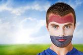Netherlands football fan in face paint — Stock Photo