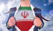 Businessman opening shirt to reveal iran flag — Stock Photo