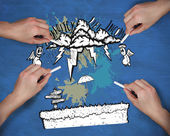 Multiple hands drawing money doodle with chalk — Stock Photo