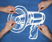 Multiple hands drawing megaphone with chalk — Stock Photo