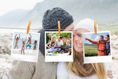 Photos hanging on a line — Stock Photo