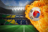 Composite image of fire surrounding korea republic flag football — Stock Photo