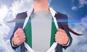 Businessman opening shirt to reveal nigeria flag — Stock Photo
