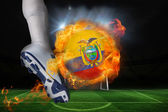 Football player kicking flaming ecuador flag ball — Stock Photo