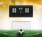 Scoreboard with no score and football — Stock Photo