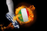Football player kicking flaming italy ball — Stock Photo